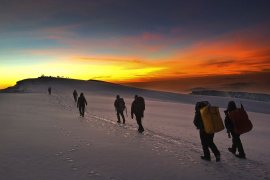 hiking to the summit at sunrise in kilimanjaro