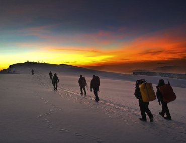 hiking to the summit at sunrise in kilimanjaro