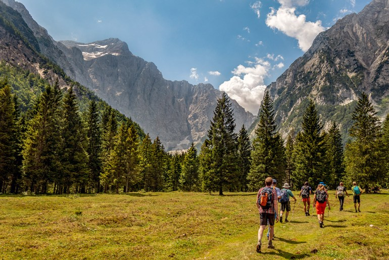 hikers in a field in Slovenia
