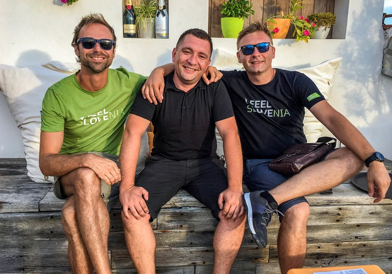 three men smiling in Slovenia