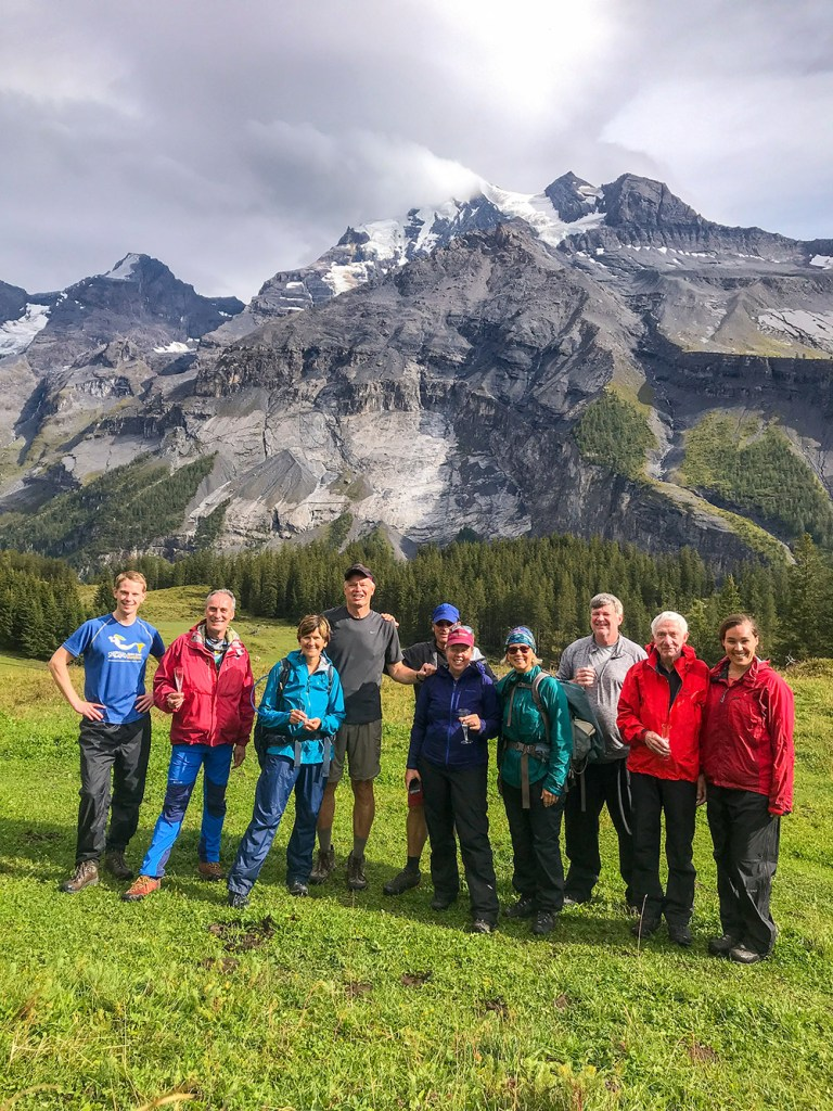 group of hikers in via alpina Switzerland