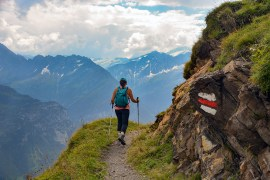 hiker on a ridge in via alpina Switzerland