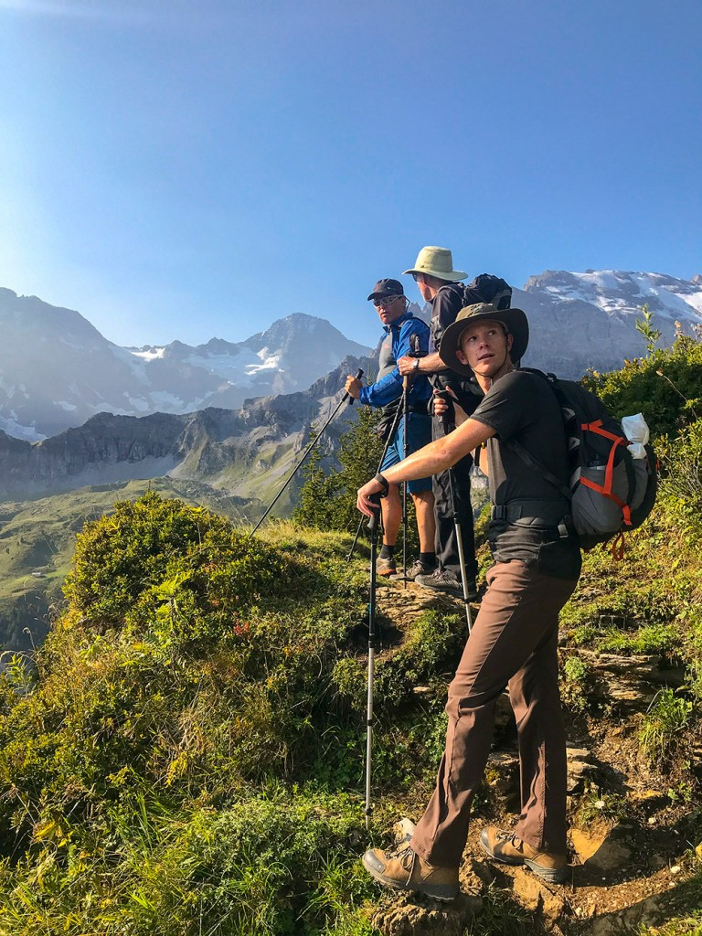hikers on trail in via alpina Switzerland