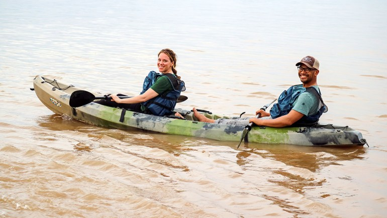 kayakers on mekong in cambodia