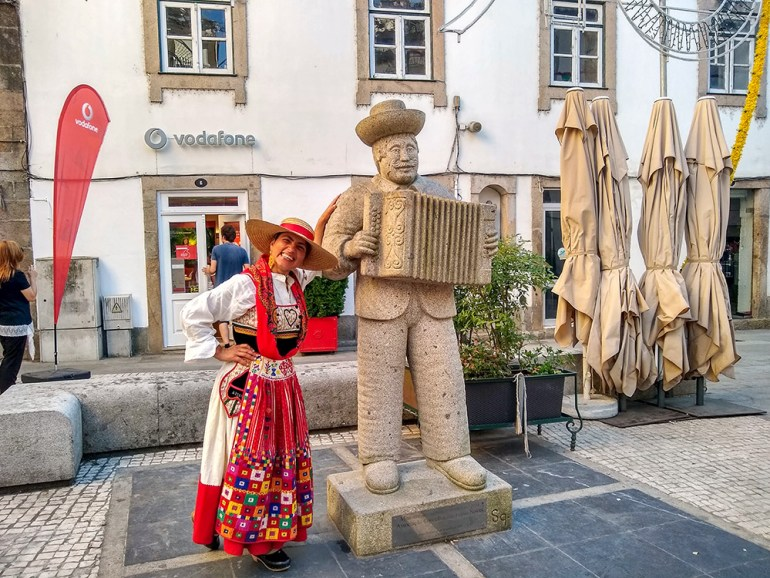 woman standing by statue in portugal