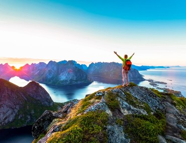 hiker in lofoten under the arctic sun