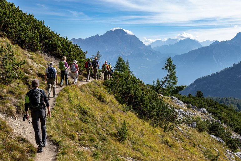 line of hikers in the Cortina Dolomites