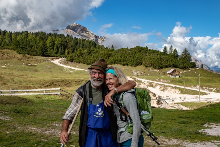 man and woman smiling in the Cortina Dolomites