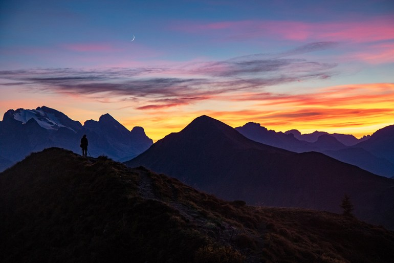 sunset with hiker in the Cortina Dolomites