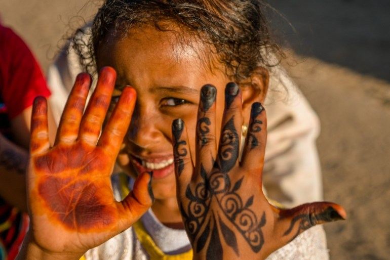 young girl showing henna on her hands in Egypt