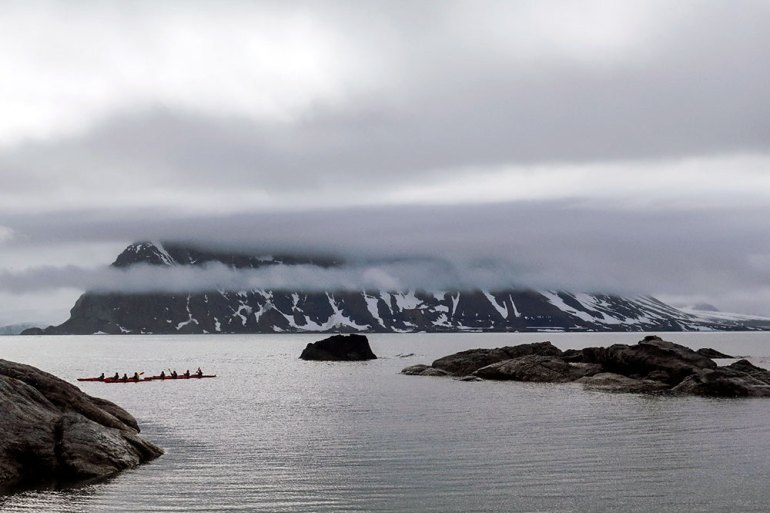 sea kayakers in the polar region