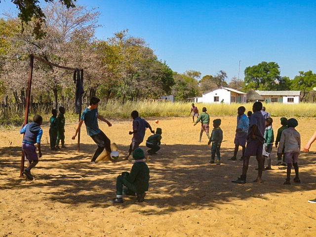 kids playing soccer in zimbabwe