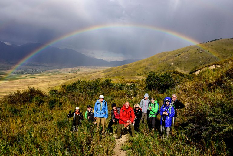 hikers under rainbow in Kyrgyzstan