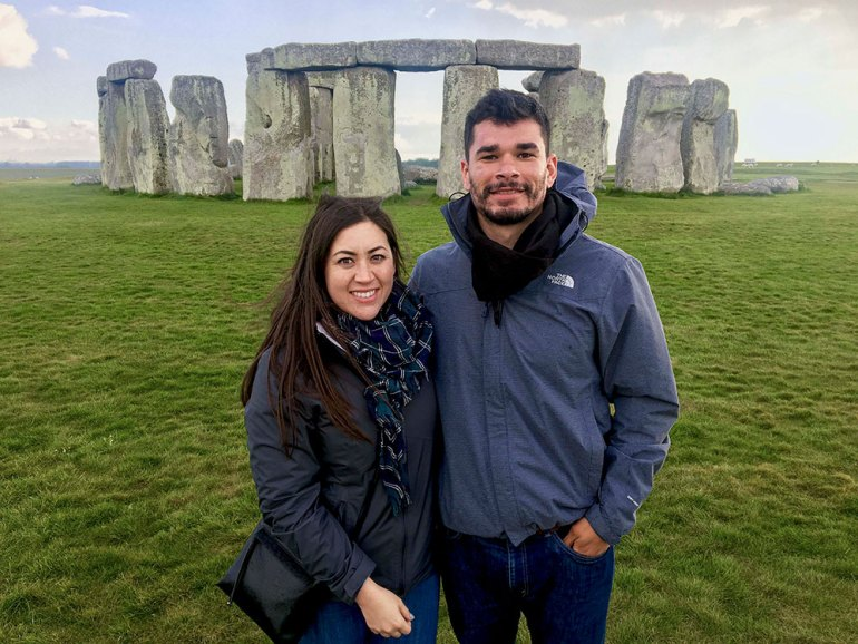 couple-standing-in-front-of-stonehenge