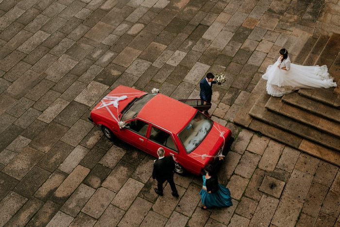 red car wedding photo