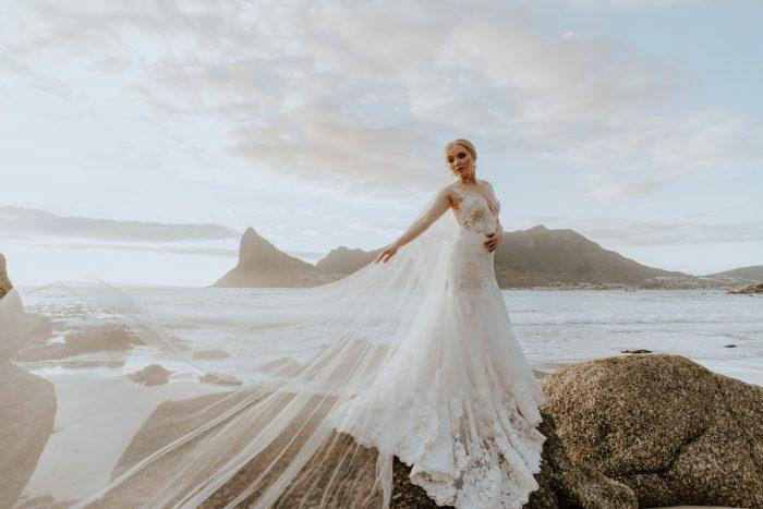 bride on rocks by sea