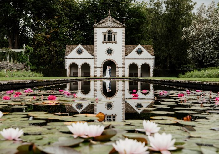 garden pond with lilies and couple