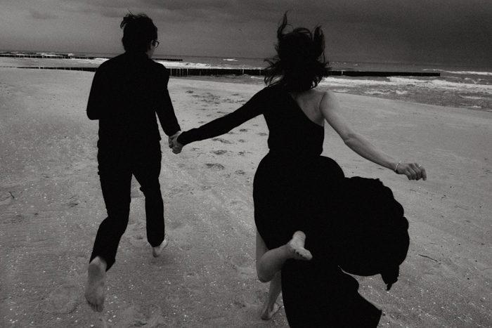 black and white running engagement photo