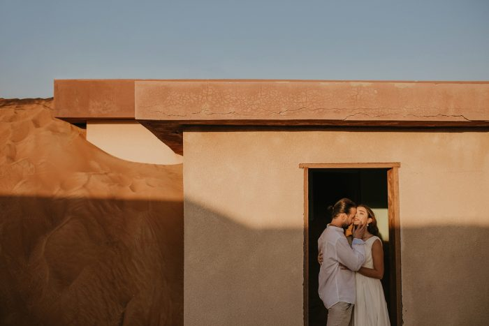 couple in front of terracotta wall