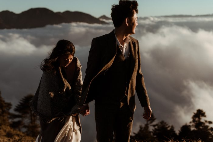 March top pic couple walking amongst clouds