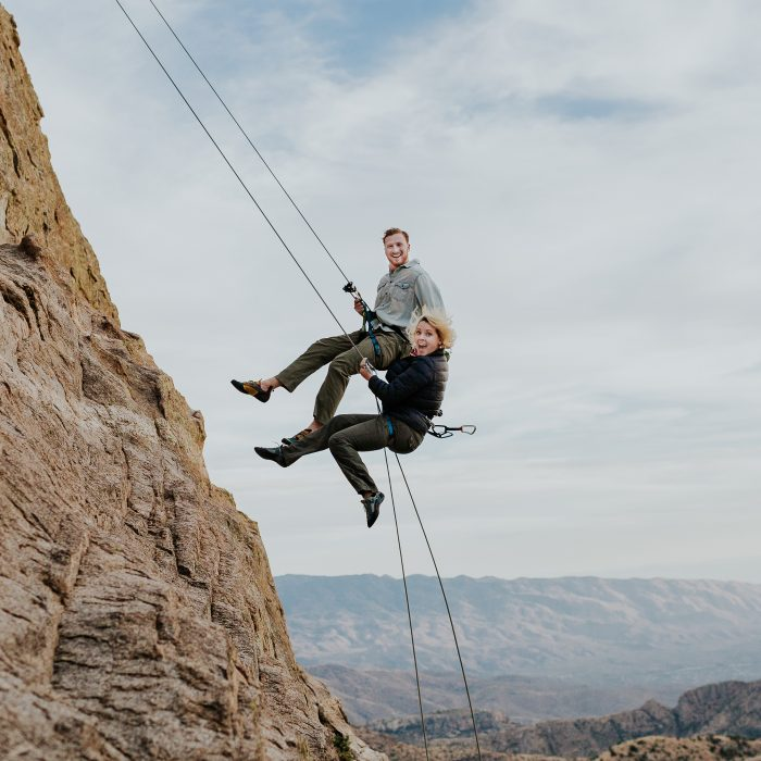 Top Pic couple rappelling down mountain