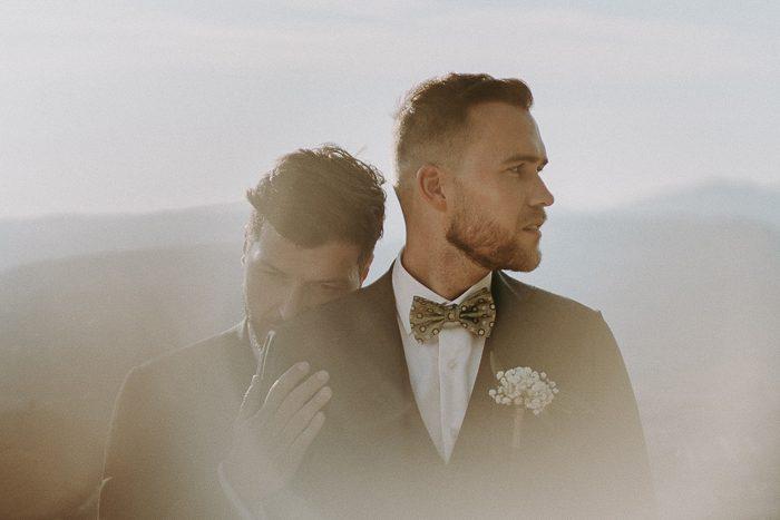 grooms embracing pinterest for wedding photographer branding graphic