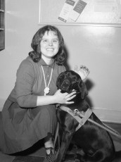GCS student Pat Hover receives seeing eye dog from G'town Lions Club 1966