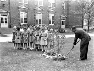 Girl Scouts & Mr Mortensen plant magnolia tree 1960