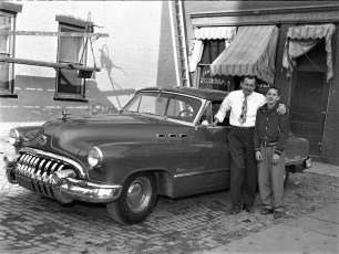 Don Wagoner & son with new Buick 1954