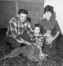 Philip Bruno and family display 30lb bobcat taken near their farm Elizaville 1961