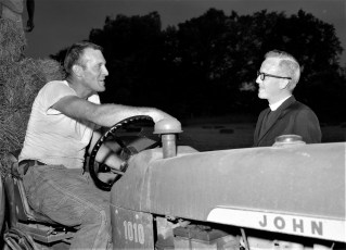 Rev. Osterloh visits with Floyd Moore 1964