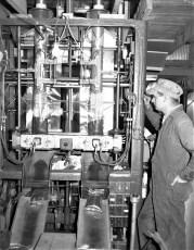 Swiss Farm William Wright at bagging machine Philmont 1954