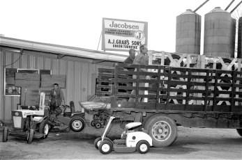 A.J. Grab's unloading new tractors Greenport 1964