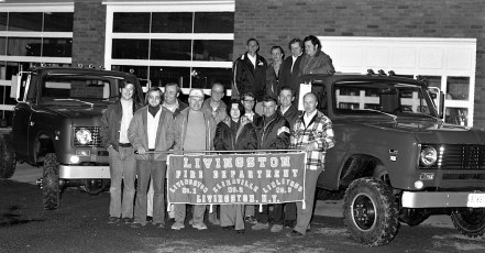 Livingston Fire Dept. members with new trucks 1975