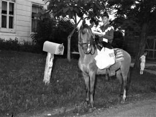 Boy delivers papers on horseback Scism Rd. Red Hook 1968