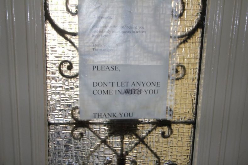 Don't let anyone come in you - Note on the door of the hostel in Amsterdam