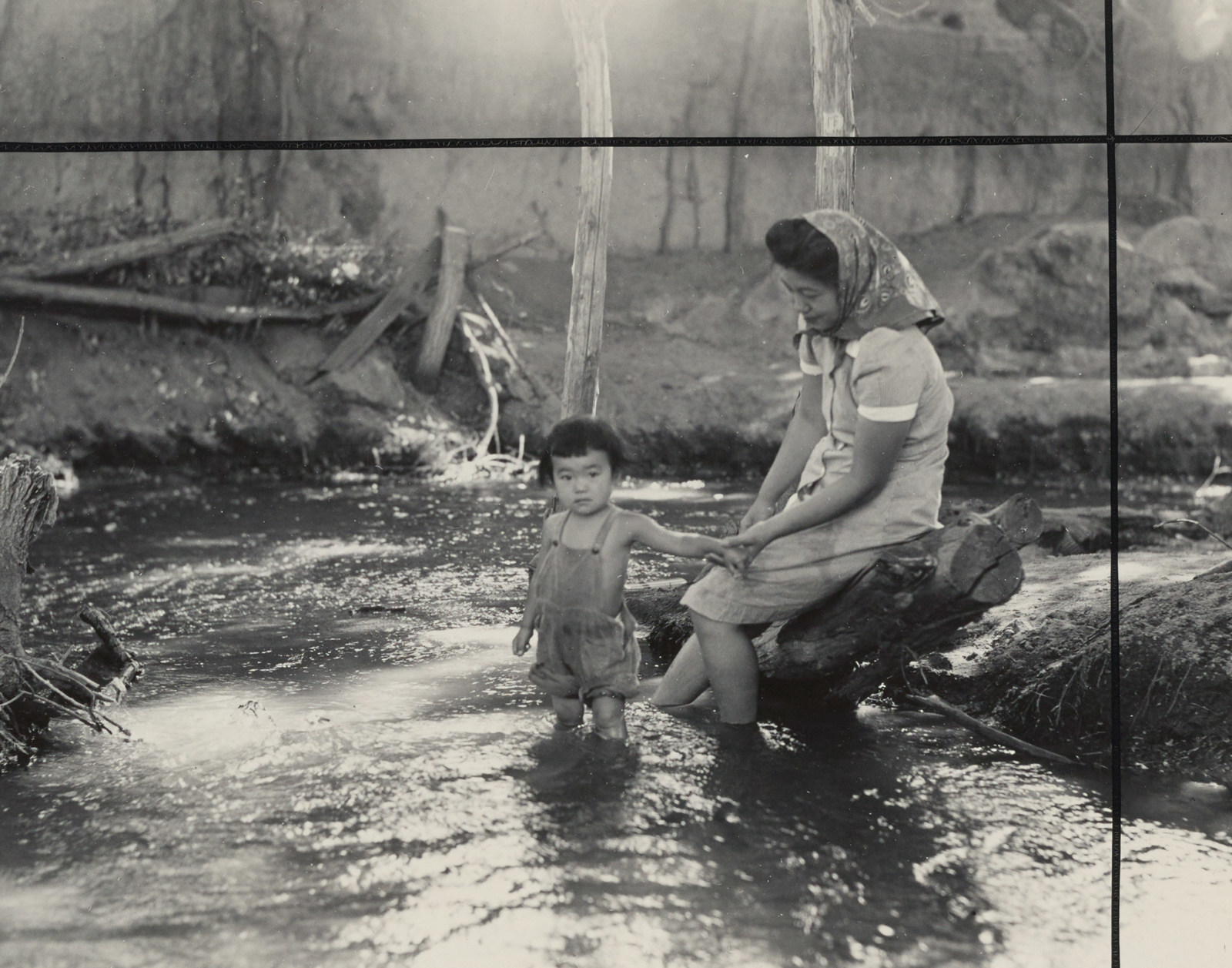 """""""Evacuees enjoying the creek which flows along the outer border of this War Relocation Authority center"""" (WRA no. C-793) Dorothea Lange, Manzanar, Calif, 1942 Courtesy of UC Berkeley, Bancroft Library"""