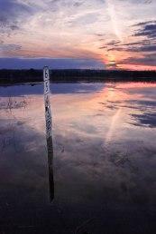 Adirodack flood with pink sunset and depth gauge reflection