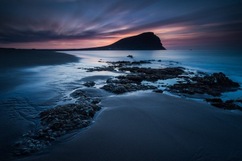 Long exposures at twilight can give dramatic results.  Photo by Michael Bolognesi.