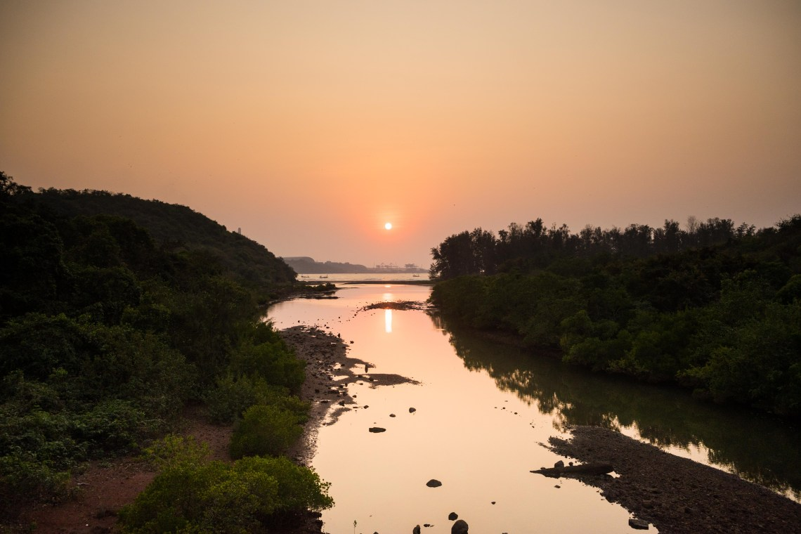 Sunset as seen over a little river in Maharashtra, India