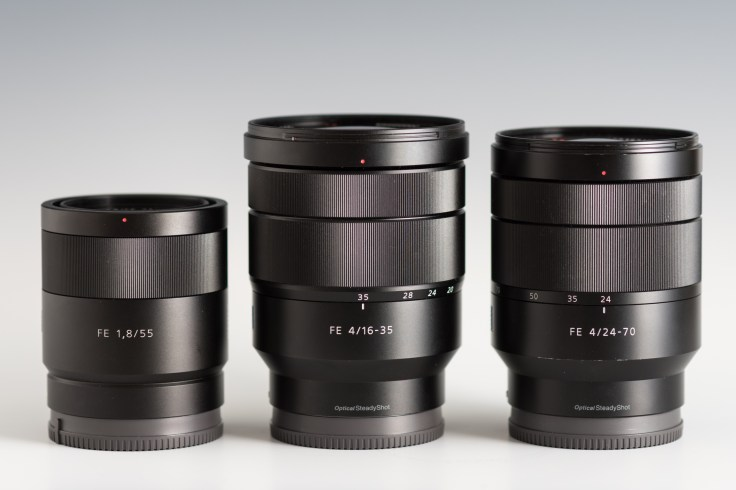 The Sony FE 16-35mm F4 (center) flanked by the Sony FE 55mm F1.8 (left) and Sony FE 24-70mm F4 (right)