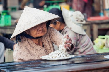 The market in Hoi An, Vietnam, was filled with fresh food and locals in the early morning, buta few hours later the souvenir shops opened and the roads were filled with tourists.