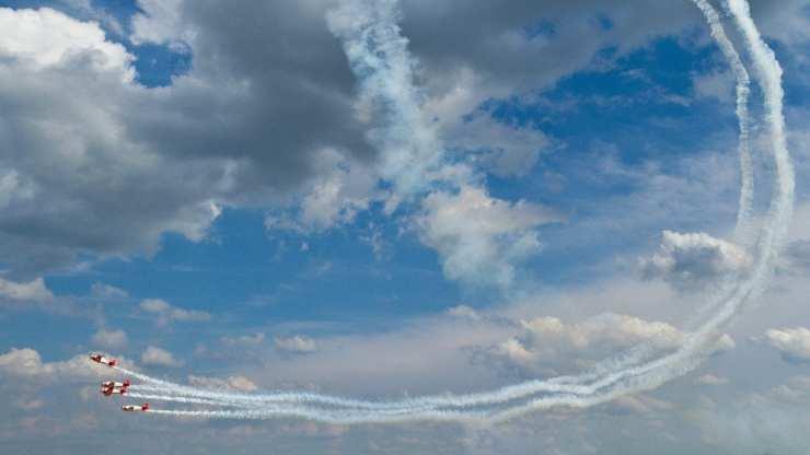 The Aeroshell airobatics team in the sky over Atlanta. Photo by Kevin Ames
