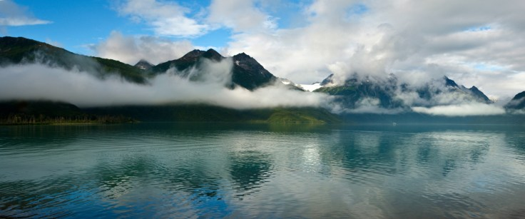 Panorama of Crescent Lake and the surrounding mountains in Lake Clark National Park Alaska. Original Image - 10625px by 3451px, ratio of 2.39:1.