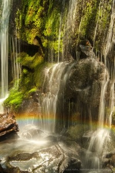 Rainbows aren't just in the sky, a long lens was used to pick this out on a small waterfall.