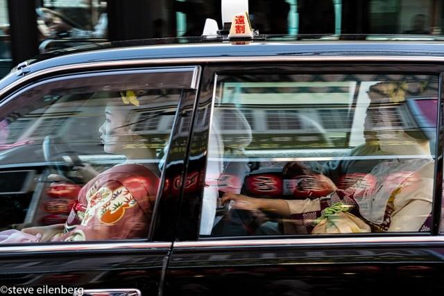 Kyoto geisha in a taxi