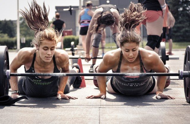 CrossFit team jumps over gear