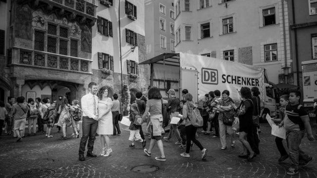 Couple, busy street, children, school trip