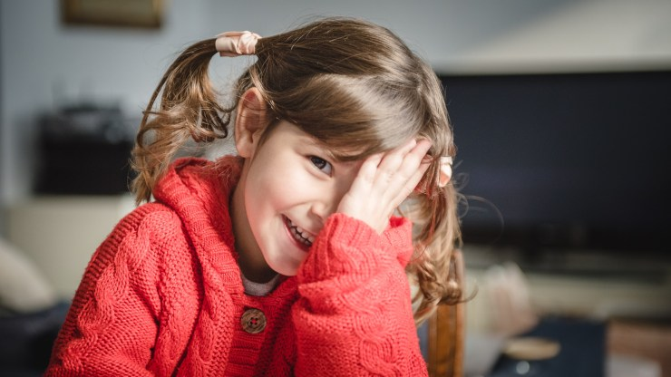 Little girl, smile, red jumper, ponytails