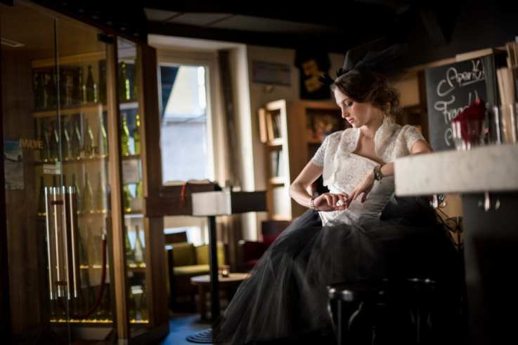 girl waiting, girl, white corset, tulle skirt, cocktail bar, young woman, black skirt, white top